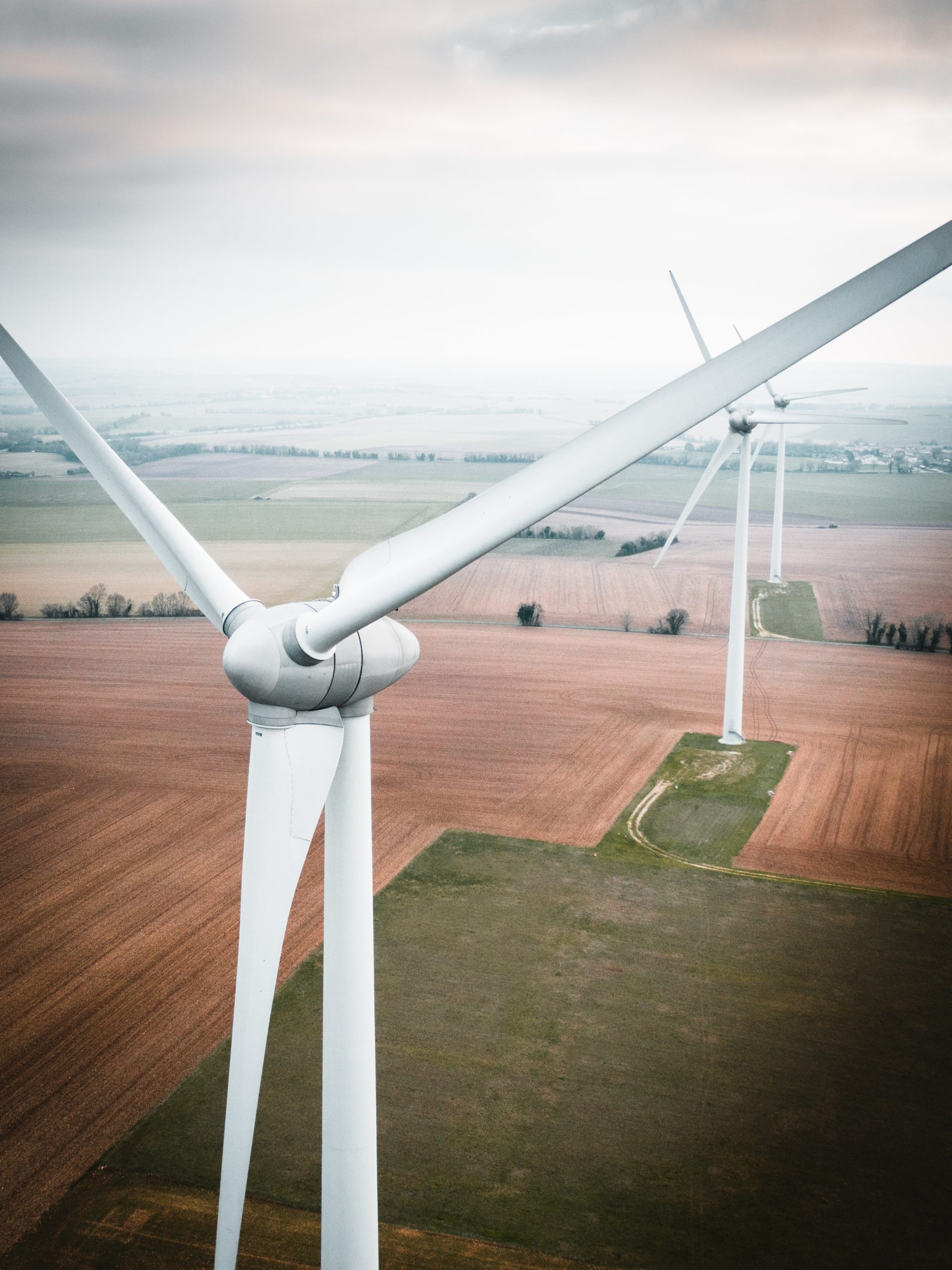 Picture of multiple windmill in a grassy fields