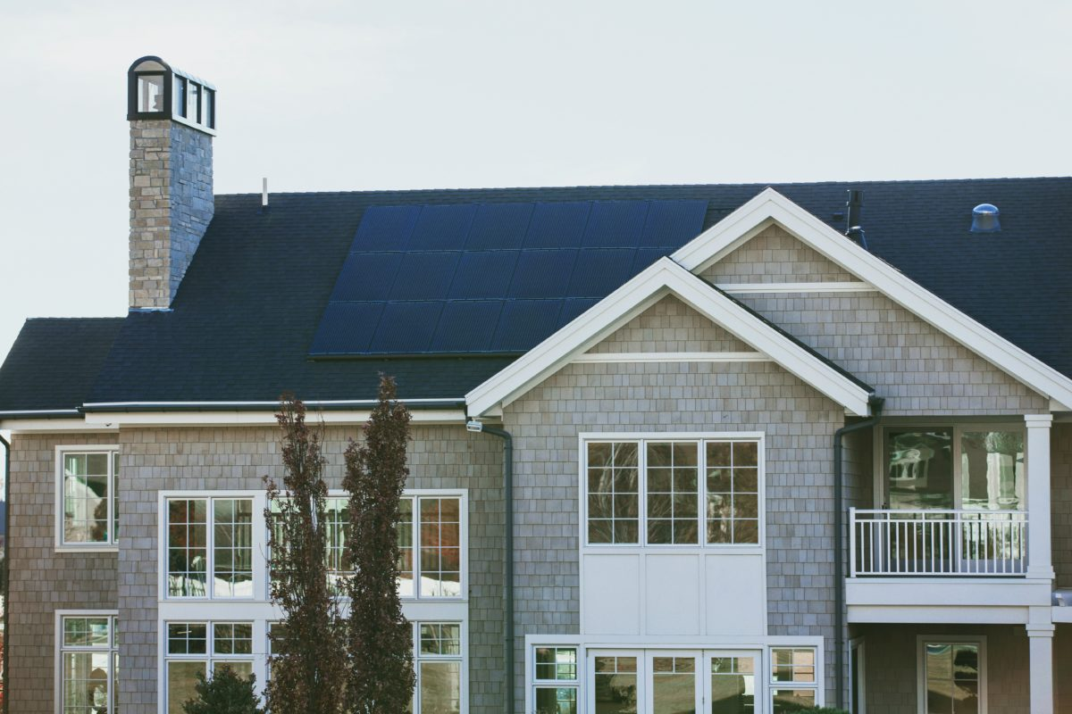 Picture of a house with solar panels on its roof